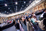 Crowds gather for a motivational speaker at Alexander Palace, London