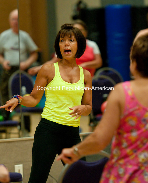 SEYMOUR,  CT, 12 SEPTEMBER 2014-091214JS05--Fitness instructor Gloria Timpanelli leads a class called Silver Sneakers Friday at Peak Fitness in Seymour. The class is specifically designed for seniors. <br />  Jim Shannon Republican-American