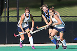 26 September 2014: Duke's Sarah Urdahl (10) is defended by California's Michaela Swensen (18) and Sydney Earle (right). The Duke University Blue Devils hosted the University of California Bears at Jack Katz Stadium in Durham, North Carolina in a 2014 NCAA Division I Field Hockey match. Duke won the game 2-0.