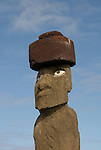 Chile, Easter Island: Statue or moai on a platform or ahu called Ahu Tahai near the town of Hanga Road.  This moia is unique as the only moai on the island restored totally with a topknot and eyes..Photo #: ch209-33111.Photo copyright Lee Foster www.fostertravel.com lee@fostertravel.com 510-549-2202
