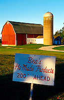 Rural scene of a red barn and silo, with a sign advertising 'Bea's Ho-Made Products 200' Ahead.'. Gills Rock, Door County, Wisconsin.
