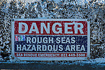 Danger sign warning of rough seas, Kalk Bay harbour, False Bay, Western Cape, South Africa