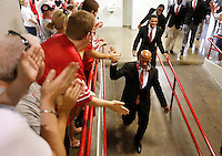 Ohio State Buckeyes linebacker Ryan Shazier (10) high fives fans as players enter St. John Arena for the first Skull Session before the Ohio State football season opener against Buffalo at Ohio Stadium in Columbus, Saturday afternoon, August 31, 2013. (Columbus Dispatch  / Eamon Queeney)