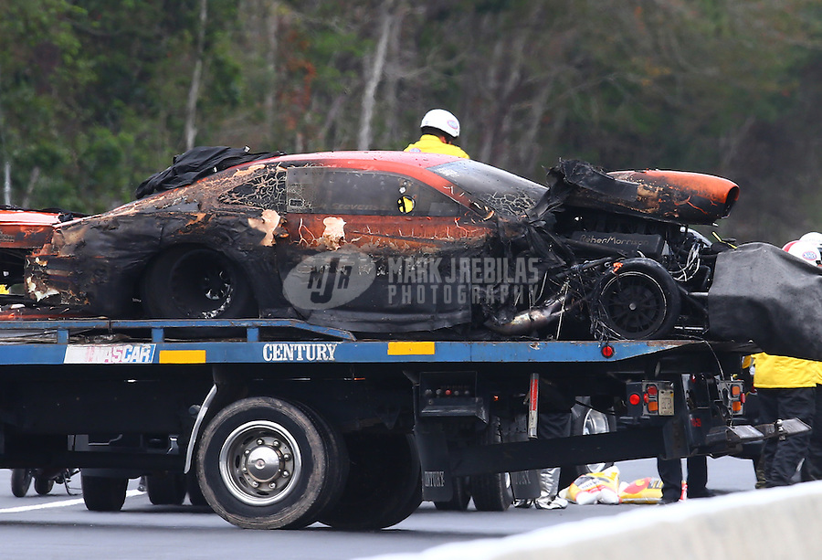 Mar 18, 2016; Gainesville, FL, USA; The burned remains of the car of NHRA pro mod driver Dan Stevenson after an engine explosion and fire during qualifying for the Gatornationals at Auto Plus Raceway at Gainesville. Mandatory Credit: Mark J. Rebilas-USA TODAY Sports