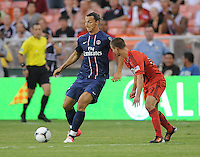 Paris St Germain forward Ibrahimovic Zlatan (18) goes against D.C. United midfielder Perry Kitchen (23) D.C. United tied Paris St. Germain 1-1 at RFK Stadium, Saturday 28, 2012.