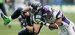 Seattle Seahawks tight end Zach Miller (86) is tackled by Minnesota Vikings safety Jamarca Sanford after catching a 25-yard pass at CenturyLink Field in Seattle, Washington on  November 4, 2012.  The Seahawks beat the Vikings 30-20.    ©2012. Jim Bryant Photo. All Rights Reserved.