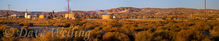 906500009 panorama oil derricks and storage tanks in a working oil field in southern kern county california