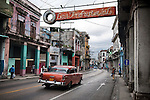 _SM16163, Havana, Cuba, 2010, CUBA-10022 A red car driving the streets of Havana. <br /> <br /> retouched_Ekaterina Savtsova 11/07/2014