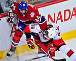 21 December 2008: Montreal Canadiens' defenseman Roman Hamrlik from the Czech Republic pushes Carolina Hurricanes' center Brandon Sutter away from the puck in the second period at the Bell Centre in Montreal, Quebec, Canada. The Hurricanes defeated the Canadiens 3-2 in overtime. ***** Editorial Sales Only ***** Mandatory Photo Credit: Ed Wolfstein Photo
