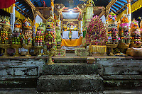 Bali, Indonesia.  Temple Offerings of Fruit, Eggs, and Sweets in Hope of a Good Rice Harvest, Pura Dalem Hindu Temple, Dlod Blungbang Village.