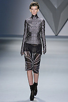 Valerija Kelava walks runway in a steel vault jacquard high neck long sleeve top over plum silk chiffon tank, and black vault print silk chiffon skirt, from the Vera Wang Fall 2012 Vis-a-gris collection, during Mercedes-Benz Fashion Week Fall 2012 in New York.