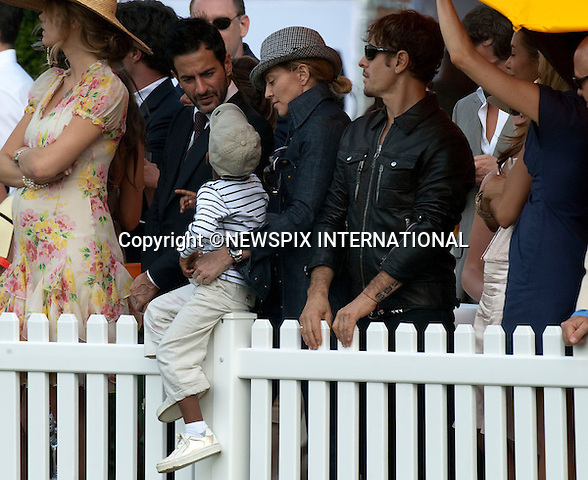 """Madonna turned up at the Veuve Clicquot Manhattan Polo Classic to cheer on Prince Harry and his Sentebale team.Madonna was accompanied by the boyfriend Jesus Luz and her children Rocco and David. The family spent the afternoon in close company with designer Marc Jacobs..Prince Harry.Attends the second annual Veuve Clicquot Manhattan Polo Classic on Governors Island.The Prince plays for the Sentebale team against the Black Watch team in a 4-chukka exhibition match_ Governors Island, New York, USA_30/05/2009.Mandatory Photo Credit: ©Dias/Newspix International..**ALL FEES PAYABLE TO: """"NEWSPIX INTERNATIONAL""""**..PHOTO CREDIT MANDATORY!!: NEWSPIX INTERNATIONAL(Failure to credit will incur a surcharge of 100% of reproduction fees)..IMMEDIATE CONFIRMATION OF USAGE REQUIRED:.Newspix International, 31 Chinnery Hill, Bishop's Stortford, ENGLAND CM23 3PS.Tel:+441279 324672  ; Fax: +441279656877.Mobile:  0777568 1153.e-mail: info@newspixinternational.co.uk"""