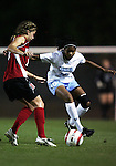 NC State's Lindsay Vera (13) tries to find a way past UNC's Ariel Harris (10) on Thursday, October 20th, 2005 at Fetzer Field in Chapel Hill, North Carolina. The University of North Carolina Tarheels defeated the North Carolina State University Wolfpack 1-0 during an NCAA Division I Women's Soccer game.