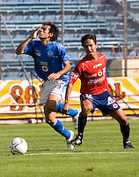 Cruz Azul forward Cesar Delgado (L) is fouled by Veracruz Tiburones Rojos midfielder Omar Rivera during their soccer match in the Azul Stadium in Mexico City, April 8, 2006. Cruz Azul won 3-0 to Veracruz. .. Photo by © Javier Rodriguez