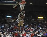 "Ole Miss guard Chris Warren (12) dunks against Arkansas at C.M. ""Tad"" Smith in Oxford, Miss. on Saturday, March 5, 2010. Mississippi won 84-74."