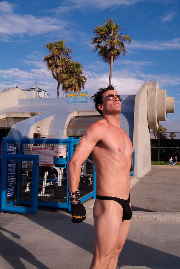 Muscle Beach weight lifter real character in skimpy suit in crazy Venice Beach California