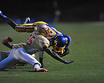 Oxford High's Nick Brown (18) tackled by Lafayette High's Will Jenkins (25) at Bobby Holcomb Field in Oxford, Miss. on Thursday, August 30, 2012. Oxford High won 19-0.