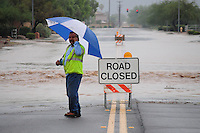 Apache Junction, Arizona (October 9, 2014) - Early flash food rains slammed cities east of Phoenix, namely Apache Junction, Gold Canyon -in Pinal County. The heavy storm waters turned roadways into rivers as flash floods trapped vehicles. The rain caused at least one rescue. Photos by Eduardo Barraza © 2014