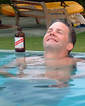 Amanoka Villa, Discovery Bay, Jamaica.  Enjoying an afternoon beer after a long day of kayaking, sunning, and swimming in Discovery Bay.  © Rick Collier......Jamaica Discovery Bay Amanoka Villa tropical island paradise beach summer fun relaxation swimming pool red stripe beer smiling cool swim Rick