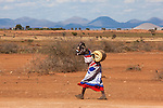 Maasai woman fetching water, Mbirikani, Kenya, October 2012