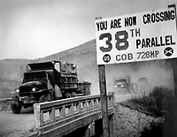 Crossing the 38th parallel.  United Nations forces withdraw from Pyongyang, the North Korean capital.  They recrossed the 38th parallel.  1950. (USIA)<br /> Exact Date Shot Unknown<br /> NARA FILE #:  306-FS-259-21<br /> WAR &amp; CONFLICT BOOK #:  1433