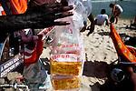 A vender sells crispy puffs of Globo snacks at the beach in Ipanema, Rio de Janeiro, Brazil, on Saturday, Feb. 2, 2013.