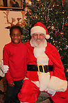 Santa Claus and Raif - Hearts of Gold links to a better life celebrates Christmas with a party #2 for mothers and their children on December 17, 2016 in New York City, New York with arts and crafts, a great turkey dinner with all the goodies and then the children met Santa Claus and had a photo with him as he gave them gifts. (Photo by Sue Coflin/Max Photos)
