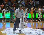 "Terry Blackburn removes wet towels from the court at Ole Miss vs. Tennessee at C.M. ""Tad"" Smith Coliseum in Oxford, Miss. on Thursday, February 24, 2011.  Tennessee won 66-39 with 5:24 remaining after officials ended the game due to a wet court."