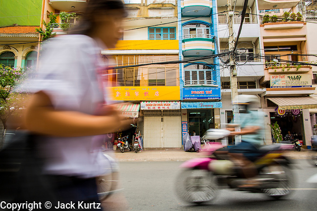 12 APRIL 2012 - HO CHI MINH CITY, VIETNAM:  Traffic on a street in Cholon. Cholon is the Chinese-influenced section of Ho Chi Minh City (former Saigon). It is the largest &quot;Chinatown&quot; in Vietnam. Cholon consists of the western half of District 5 as well as several adjoining neighborhoods in District 6. The Vietnamese name Cholon literally means &quot;big&quot; (lon) &quot;market&quot; (cho). Incorporated in 1879 as a city 11&nbsp;km from central Saigon. By the 1930s, it had expanded to the city limit of Saigon. On April 27, 1931, French colonial authorities merged the two cities to form Saigon-Cholon. In 1956, &quot;Cholon&quot; was dropped from the name and the city became known as Saigon. During the Vietnam War (called the American War by the Vietnamese), soldiers and deserters from the United States Army maintained a thriving black market in Cholon, trading in various American and especially U.S Army-issue items.        PHOTO BY JACK KURTZ