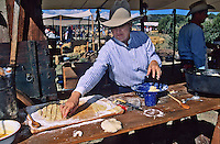 A cowgirl chef competes with the men at her chuckwagon at the Lincoln County Cowboy Symposium held each fall in sourhern New Mexico.