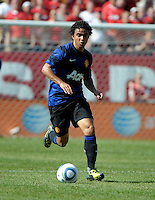 Manchester United defender Fabio da Silva (20) dribbles down the field.  Manchester United defeated the Chicago Fire 3-1 at Soldier Field in Chicago, IL on July 23, 2011.
