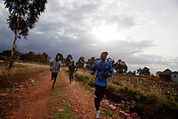 Kenyan athletes (L-R) Johanna Kariankei, Joseph Langat and Elias Maindi  train in the hills close to Iten town, the country's running capital. The global recession has robbed races and runners of sponsorship, cutting their chances of earning a living from running.