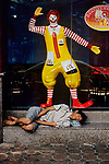 00021_12, Bangkok, Thailand, 2004, THAILAND-100017. A homeless man sleeps outside of a McDonald's restaurant. <br />