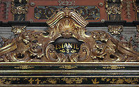 Detail of a bookcase with Chinese motifs, lacquer and gilding by Manuel da Silva, in the Green Room of the Joanina Library, or Biblioteca Joanina, a Baroque library built 1717-28 by Gaspar Ferreira, part of the University of Coimbra General Library, in Coimbra, Portugal. The Casa da Livraria was built during the reign of King John V or Joao V, and consists of the Green Room, Red Room and Black Room, with 250,000 books dating from the 16th - 18th centuries. The library is part of the Faculty of Law and the University is housed in the buildings of the Royal Palace of Coimbra. The building is classified as a national monument and UNESCO World Heritage Site. Picture by Manuel Cohen