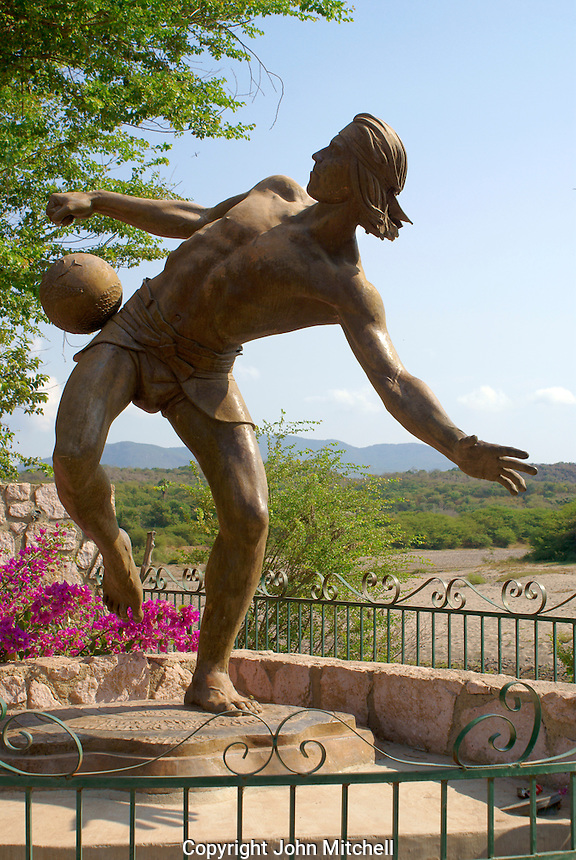 Statue of a man playing the pre-Hispanic game of  Ulama  in the town of El Quelite near  Mazatlan, Sinaloa, Mexico