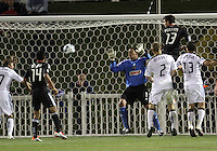 Chris Pontious(13) of D.C. United heads past Faryd Mondragon(1) of the Philadelphia Union during a play-in game for the US Open Cup tournament at Maryland Sportsplex, in Boyds, Maryland on April 6 2011. D.C. United won 3-2 after overtime penalty kicks.