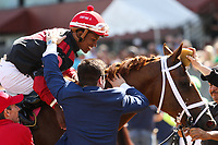HOT SPRINGS, AR - April 15: Jockey Ricardo Santana, Jr. and Chance Moquett hug after Whitmore #8 won the Count Fleet Sprint Handicap at Oaklawn Park on April 15, 2017 in Hot Springs, AR. (Photo by Ciara Bowen/Eclipse Sportswire/Getty Images)