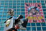Garden City, New York, USA. 14th June 2015. The tall Robotman metal sculpture, by artist C. Evan Gray, is on display outdoors in front of the Eternal Con banner on the glass facade of the Cradle of Aviation Museum, at Eternal Con, the Long Island Comic Con. The sculptor created it from automotive and other parts.