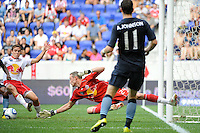 New York Red Bulls goalkeeper Greg Sutton (24) dives for a ball. The New York Red Bulls defeated Manchester City F. C.2-1 during a Barclays New York Challenge match at Red Bull Arena in Harrison, NJ, on July 25, 2010.