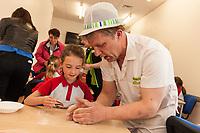 ASDA Newark baker Mark Smith shows Rainbow Gracie Brooks, 6, how to knead dough