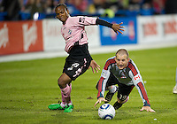 28 April 2010: Toronto FC forward Chad Barrett #19 battles with Montreal Impact defender Stephen deRoux #23 during a Nutrilite Canadian Championship game between the Montreal Impact and Toronto FC at BMO Field in Toronto..Toronto FC won 2-0.....
