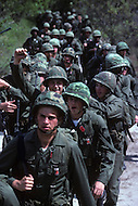 Fort Dix, NJ, USA, June 1980. US Army military training. Groups of recruits march in column for several miles every day under the supervision of their instructors.
