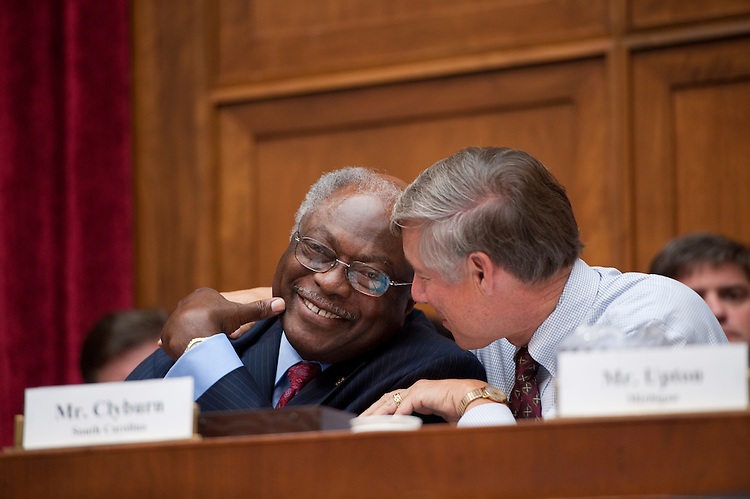 UNITED STATES - SEPTEMBER 8: From left, Rep. James Clyburn, D-S.C.,  and Rep. Fred Upton, R-S.C., talk during the first Joint Deficit Reduction Committee meeting on Thursday, Sept. 8, 2011 (Photo By Bill Clark/Roll Call)