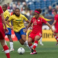 Canadian midfielder Desiree Scott (11) passes the ball as Brazilian midfielder Beatriz (13) closes. In an international friendly, Canada defeated Brasil, 2-1, at Gillette Stadium on March 24, 2012.