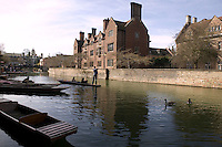 View of Magdalene College (background) and punts moored on the River Cam in Cambridge, United Kingdom, 11 March 2007.