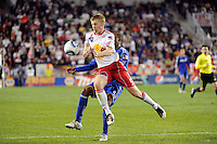 Tim Ream (5) of the New York Red Bulls takes the ball away from Teal Bunbury (9) of the Kansas City Wizards. The New York Red Bulls defeated the Kansas City Wizards 1-0 during a Major League Soccer (MLS) match at Red Bull Arena in Harrison, NJ, on October 02, 2010.