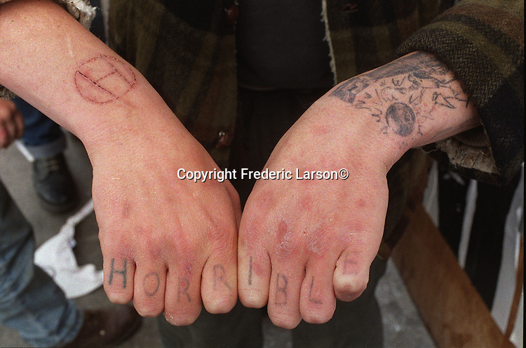 """""""Farmboy"""" friends of Travis and Dante has their bands name tattooed on his fingers."""