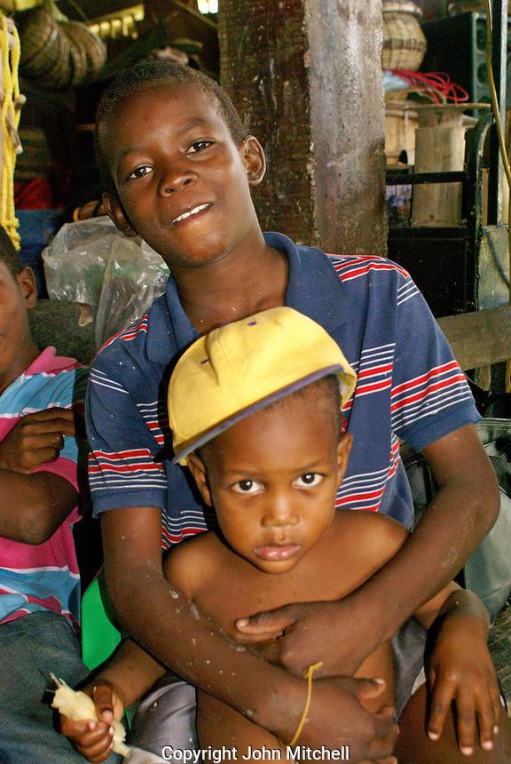 Garifuna boy and his little brother in the Garifuna village of Triunfo de la Cruz, Honduras...
