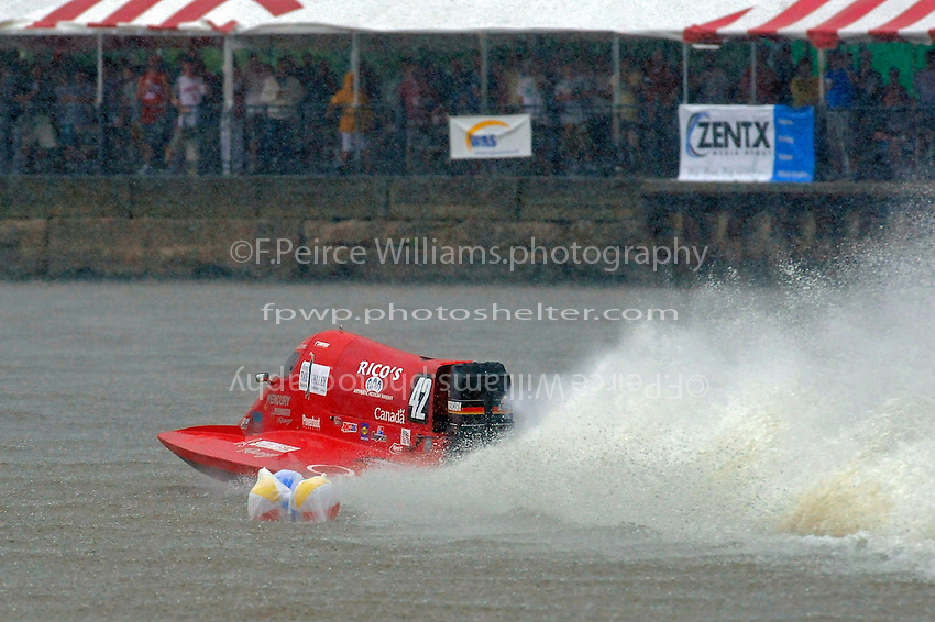 Polesitter Shaun Torrente (#42) leads past the commitment buoy in the pouring rain.   (Formula 1/F1/Champ class)