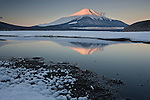 Mount Fuji might be the most recognizable symbol of Japan. It's easy to understand why this eleven-thousand-foot mountain is revered for its ancient slopes and sublime symmetry. This image was shot on a perfectly calm, crystal-clear day in the dead of winter.